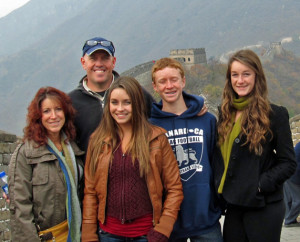 Suzy Garrett with her family at the Great Wall of China.